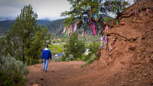 On the way down the hill, a walker passes Annie's Wishing Tree, a prominent landmark in Glenwood Springs that is becoming famous around the world.