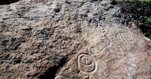 Petroglyphs, star maps, moon and owl.